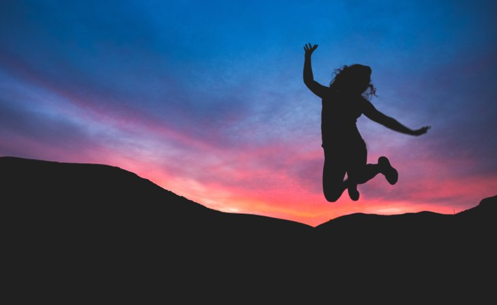 Girl jumping in joy